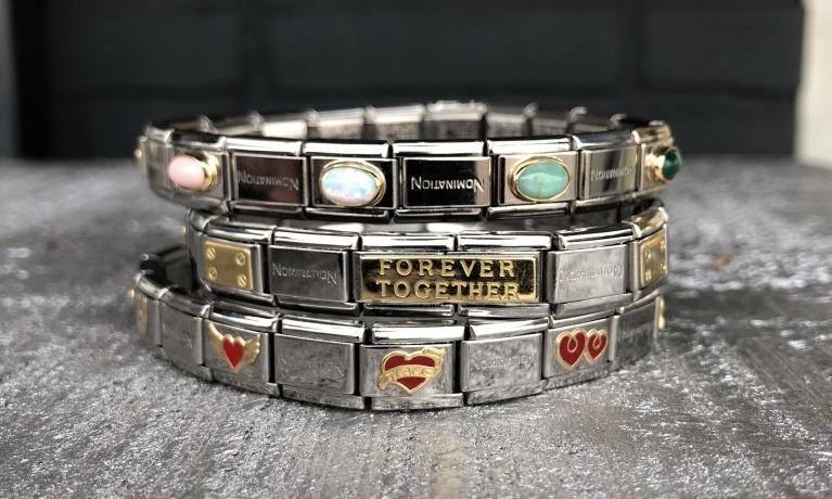 Nomination, stalen armbanden met schakels van 18 krt.