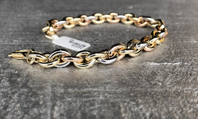 Nieuw, Gouden armband in drie kleuren goud.